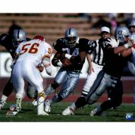 "Oakland Raiders Bo Jackson Rushing Against Chiefs (Signed In Black) Signed 16"" x 20"" Photo"